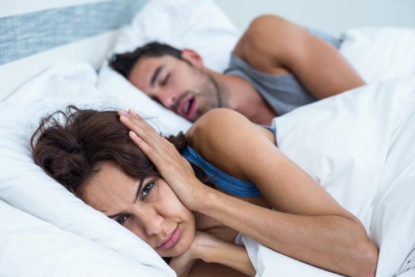 snoring partner disturbing the sleep of the other partner